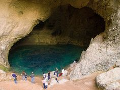 Students from the Savannah College of Art and Design (SCAD) Lacoste campus explore the cave at the source of the Sorgue river in Fontaine de Vaucluse, Provence, France