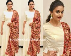 Keerthy Suresh taped an episode of Naam Oruvar TV show wearing an off-white floor length anarkali suit paired with printed dupatta by Ashwini Reddy. Matching jhumkas and a simple ponytail complemented her look! Simple Kurta Designs, Kurta Designs Women, Salwar Designs, Blouse Designs, Indian Attire, Indian Outfits, Frock Fashion, Fashion Outfits, Frock Models