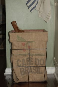 Basket made out of a coffee sack.other thought - burlap covers for tall laundry baskets. Burlap Projects, Burlap Crafts, Tall Laundry Basket, Coffee Bean Sacks, Burlap Coffee Bags, Diy Cadeau, Burlap Sacks, Feed Bags, Coffee Crafts