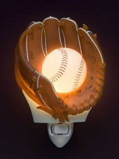 """Baseball Night Light by Ibis & Orchid Nightlights. $17.95. Our extensive collection of nightlights are truly inspired by nature, beautifully sculpted, cast in bonded marble, and expertly hand painted to provide a lasting accessory for your home or a wonderful gift. Each light is nicely gift boxed, complete with bulb and approximately 3"""" x 6"""". UL Listed."""