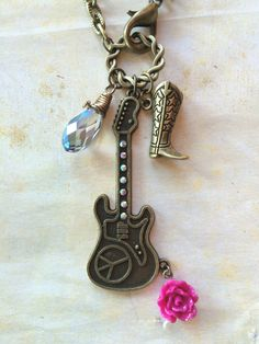 A personal favorite from my Etsy shop https://www.etsy.com/listing/476641063/guitar-charm-necklacecharm