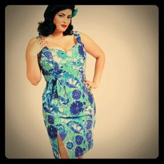 Cherry Velvet Ginger Azure Pinup Retro Dress NWT Beyond sexy! I SOOO wish this fit me!! Labeled a size 0X, which for Cherry Velvet is the equivalent of a 16/18W. Different tones of blue and aqua green retro floral pattern, zips up back with hook closure. Sleeveless with sweetheart neckline. Higher slit on right side of skirt, and has a mock tie off center to the right on the pleated banded waist. Length pictured on model is accurate, about 1 inch above knee. NWT by Cherry Velvet. Cotton, no…