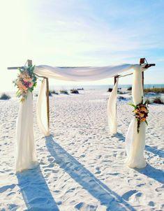 Designed By Scarletts Flowers Sandbarwedding Beachweddingarch Bambooarch Scarlettsflowers Beachflowers Bradenton Beach