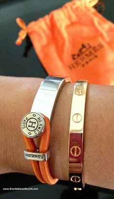 Hermes with Cartier.ugh I've wanted this Cartier love bracelet for 20 years! Cartier Armband, Bracelet Cartier, Bracelet Hermès, Hermes Bracelet, Cartier Jewelry, Jewelry Watches, Hermes Jewelry, Jewelry Accessories, Fashion Accessories