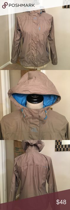 Helly Hansen Packable Raincoat Light brown with blue lining and details. Has a zipper and Velcro closure. There are also a couple of snaps. Zipper pockets, adjustable at the wrists and also the hood. This is a great raincoat, keeps you dry and also warm even though it's not bulky. Size extra small and will also fit a small. Great used condition. Helly Hansen Jackets & Coats