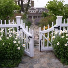 Be Welcomed by Daisies--The Friendliest Flower And A Little White Gate Accessorized In Black.