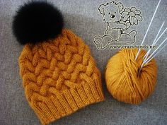 This knitted hat pattern with cables is definitely worth spending your time to get a whimsical looking hat for winter time. Attach a fur pom pom to add an elegant touch.