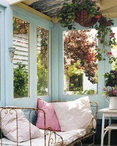 cozy corner, indoor/outdoor, tea room:  hanging flowers, dark brown, gold, sand, white, yellow, melon, pink, purple, dark green accents