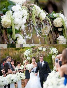 A Beautiful flower-ful wedding arch with jewels and strips of dried twigs creates a lovely effect...♡