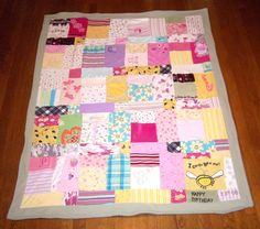"Baby Clothes Memory Quilt - a cool way to ""save"" baby clothes with sentimental value without just storing them in a bin!"
