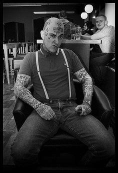Fully tattooed skinhead.