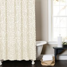 Add a lovely touch to your master bath or guest powder room with this eye-catching shower curtain, showcasing a circular motif for stylish appeal.