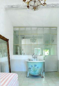 chandelier and window wall in the bathroom