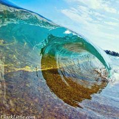 Crystal clear water rolling up on the shore of #Hawaii. Photo by Clark Little