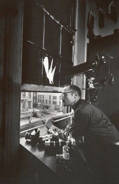 """blockmagazine-deactivated201601: """"W. Eugene Smith at fourth-floor window of 821 Sixth Avenue, circa 1957 Courtesy of the W. Eugene Smith Archive, Center for Creative Photography, The University of..."""