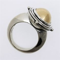 Lune Ring | A large 14k cabochon in a layered frame with studs crests an elegant 925 silver ring. Silver and 14k gold. Part of the Celtic Medieval Collection. philippeplanas.com
