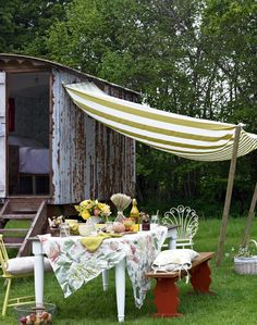 Country Garden with Outside Dining Area and Striped Canopy