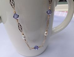 A personal favorite from my Etsy shop https://www.etsy.com/listing/223332687/tanzanite-swarovski-crystal-freshwater