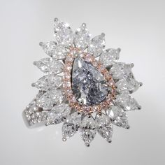Novel Collection Asia. Spectacular color and hue of blue emphasised with pink and white diamond halo.  #NovelCollection