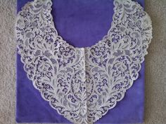 Venise needlelace, Belgian from the style of the flower center fillings and other decorative 'mode' fillings.