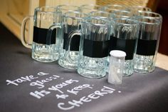 Beer glasses with chalk board labels for favors and to use during the party - bed bath & beyond has a set of 4 for $10