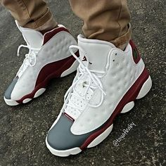 Jordan 13s, white, gray and maroon... Js are so hard to find, but these are exclusive.. Thanks Jordan Release dates for the post!