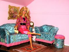 Plastic barbie couch covered in vintage fabric. The little chair I made completely out of illustration board.