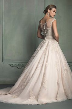 Such a breathtaking blush wedding dress with beautiful lace details. Allure, 2014