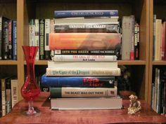"""""""Call of the Wild"""" - Through the valley / The deathly hallow / The call of the wild / Into the green / The eyes of the dragon / The teeth of the tiger / The beast was out there #butler book spine poetry"""