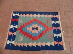 Traditional handwoven wool Kilim rug. Handmade by Turkish people.  Organic kilim rugs, all colored with vegetable dyes.  This piece is very versatile