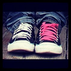 my black Converse are like this, pink laces in one, black in the other.