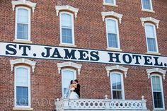 Bride & groom kiss on balcony at the St. James Hotel in Red Wing, Minnesota Photo by Brovado Weddings