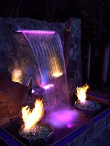 Glass fire pit and waterfall! I want this in my backyard. ♨