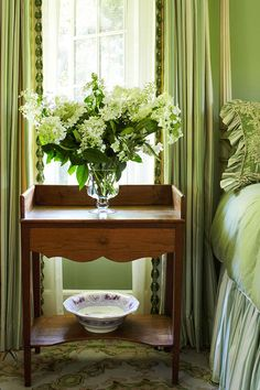 Still life: green room floral on antique American washstand used as a bedside table   --  You've Never Seen a'Beach House' Like This - Traditional Home