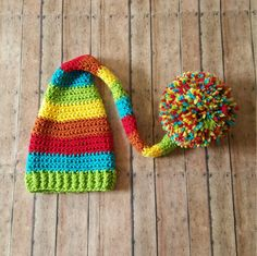 This super cute rainbow colored hat is made using 100% soft, acrylic yarn.  Perfect for newborn photos.