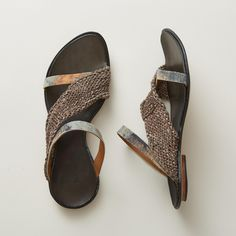 """SIAMESE SLIDES--A casual, asymmetrical band of woven leather creates visual intrigue in these exquisitely comfortable, CYDWOQ sandals that mold to your feet, getting better with each step. Leather. USA. Exclusive. Euro whole sizes 36 to 42. 36 (US 6), 37 (US 7), 38 (US 8), 39 (US 9), 40 (US 10), 41 (US 10.5), 42 (US 11). 1/8"""" heel."""
