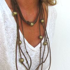 Minimalist Boho Jewelry of multi strand leather and golden geometric beads #bohojewelry #leatherjewelry #minimalistjewelry