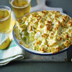 A classic pie of fish in white sauce, topped with a simple bread and soufflé style topping. Equipment: You will need a pint shallow, wide-based, ovenproof dish. From BBC By Mary Berry From Food & Drink Pie Recipes, Seafood Recipes, Cooking Recipes, Healthy Recipes, Mary Berry Fish Pie, Casseroles, Quiche, Good Food, Yummy Food