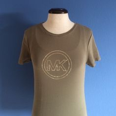 Michael Kors T-Shirt This trendy T-shirt is perfect for any closet.  Layer with a tank top, wear with a blazer, there are so many things you can do!  Material - 95% Cotton/5% Spandex Michael Kors Tops Tees - Short Sleeve