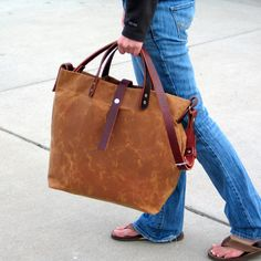 Waxed Canvas Tote with Leather Handles and Detachable Leather Strap. $110.00, via Etsy.  Great transitional tote from COLD to WARMER weather