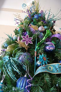 Peacock theme Christmas tree.  Wonder if I could get away with this, or if my husband would think I'm crazy.