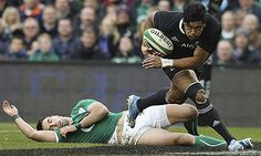 Julian Savea of the All Blacks breaks clear to score their first try against Ireland in the Autumn international 2013.