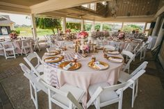 Wedding reception design- tables with  Peonies, Aneomones, & Ranunculus arrangements and chevron tablecloths | Outer Banks corolla wedding, Currituck Club by Renee Landry Events