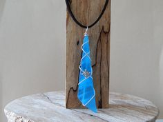 Check out this item in my Etsy shop https://www.etsy.com/listing/275155170/blue-stained-glass-pendant-art-glass
