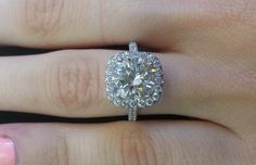 Repin if you'd say YES to our brand new 2.64 ct round set in a cushion shaped halo engagement ring!