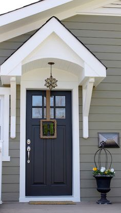 """Sherwin-Williams """"Inkwell"""" on the front door and """"Hardware"""" on the siding."""