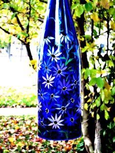Wine Bottle Wind Chime Blue Bottle with Purple Flowers.