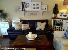 Idea to use shelf above couch. I like it!