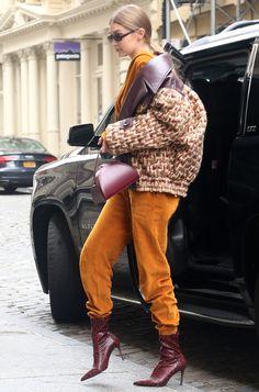 Gig Hadid red snakeskin Mango booties.
