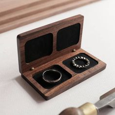 The Woodsbury wedding ring box is simple, yet perfectly hand crafted from the finest bookmatched walnut timber. Each wedding box has been designed to fit easily into your pocket, while firmly holding both rings in position regardless of movement. We have also added two discreet magnets hidden underneath the timber, which holds the box firmly together. Our ring boxes are custom designed to suit each customer and are made to last a lifetime. *PLEASE NOTE:* Prior to purchase please measure the…